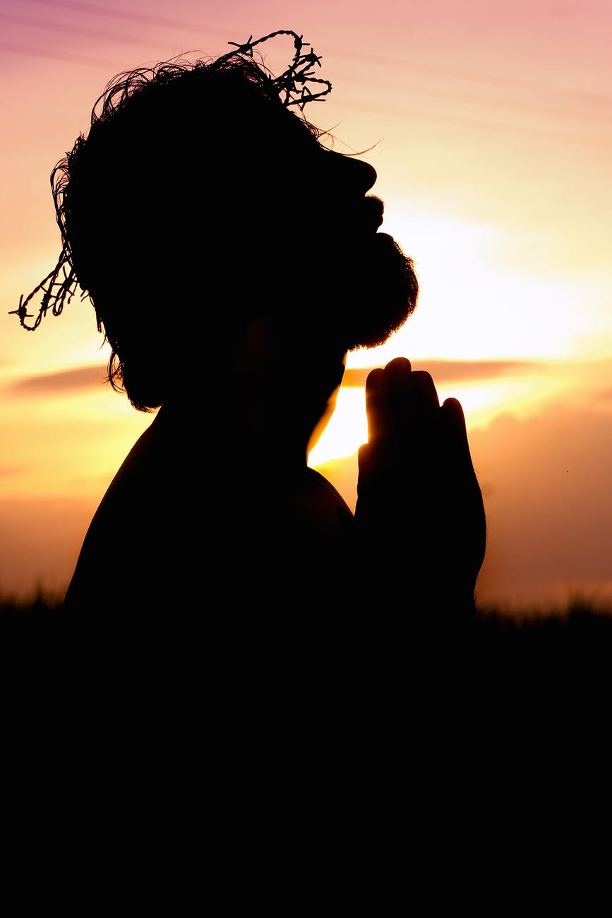 silhouette image of person praying